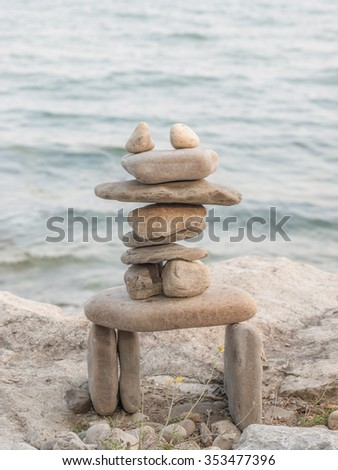 Inukshuk rock piles by Lake Ontario in Oakville, Ontario, Canada. - stock photo