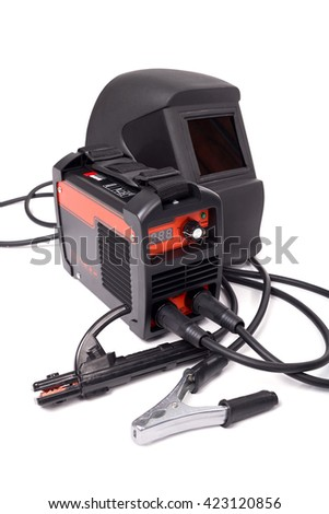 Inverter welding machine, welding equipment, isolated on a white background, welding mask, welding electrodes, high-voltage wires with clips, set of accessories for arc welding. - stock photo