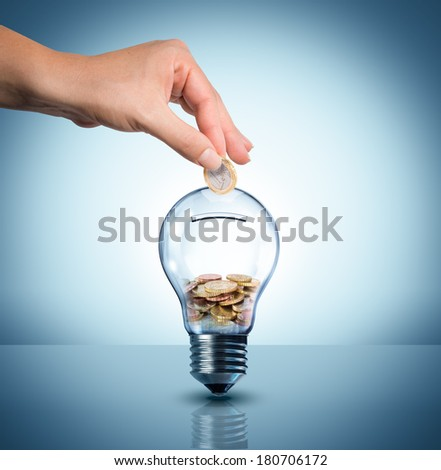 invest to energy concept - euro in bulb - piggy bank  - stock photo