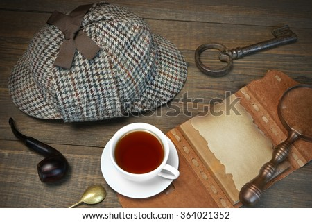 Investigation Concept. Private Detective Tools On The Wood Table Background. Deerstalker Cap,  Magnifier, Key, Cup, Notebook, Smoking Pipe. Overhead View - stock photo