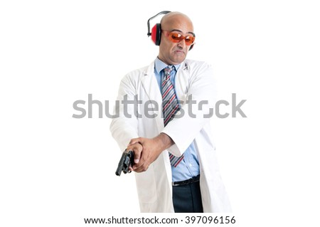 Investigator processing a hand gun - stock photo