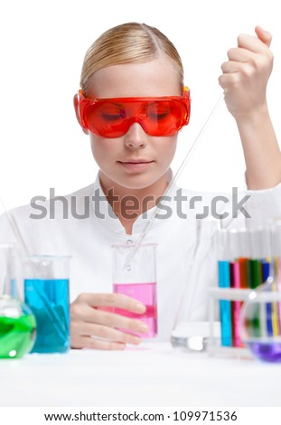 Investigator tests purple liquid in beaker, isolated on white