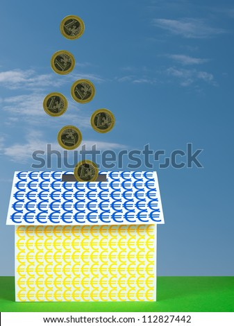 Investing in Euros moneybox property - stock photo