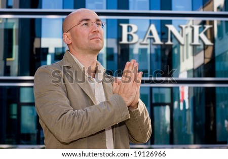 investment banker praying - stock photo