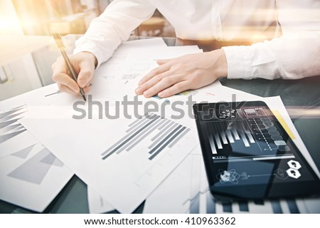Investment manager working process.Picture trader work market report modern tablet.Using electronic device.Graphic icons,stock exchange reports screen.Business project startup.Horizontal,film effect - stock photo
