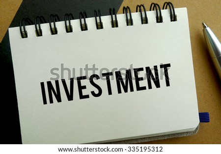 Investment memo written on a notebook with pen