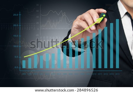 Investor drawing growth chart of profits. - stock photo