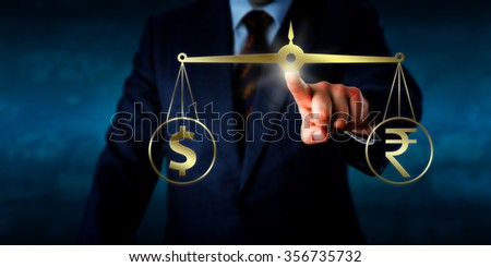 Investor is trading the Indian rupee at par with the US dollar. A virtual golden pair of balances is keeping the dollar sign and the rupee currency symbol in temporary equilibrium. Business concept. - stock photo