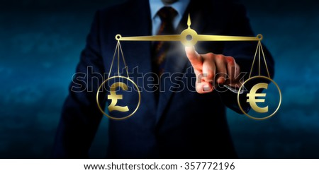Investor trading the British pound sterling at par with the Euro. A golden pair of scales are keeping the pound sign and euro currency symbol in equilibrium. Business concept for currency exchange. - stock photo
