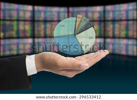 Investors with pie chart on hands. - stock photo