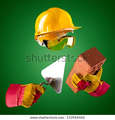 invisible builder with trowel and brick on a green background - stock photo