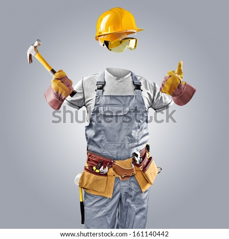 invisible worker in helmet with hammer - stock photo