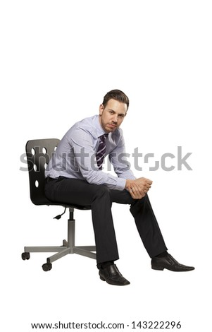 Inviting business man sitting on chair with relaxed attitude
