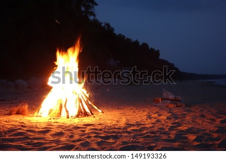 Inviting campfire on the beach in Michigan along Lake Michigan - stock photo