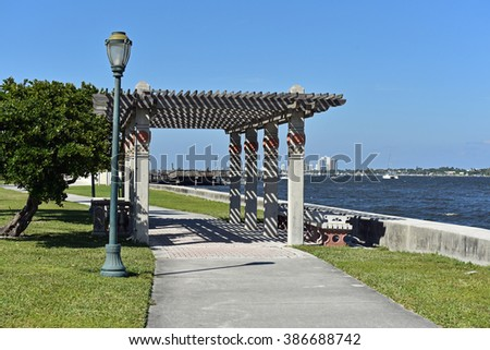 Inviting park and pedestrian walkway in downtown West Palm Beach, Florida. - stock photo
