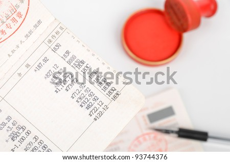 Invoice and passbook - stock photo