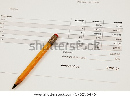 Invoice and vintage pencil