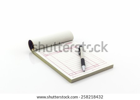 Invoice book which open blank page with pen on white background. - stock photo