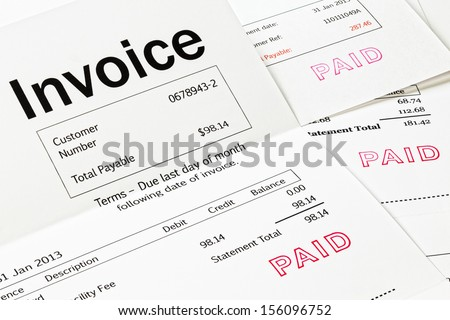 Invoice with Paid Stamp - three invoices with paid stamped on them. All details are imaginary. - stock photo