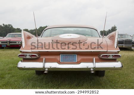 IOLA, WI - JULY 12:  Back of 1959 Plymouth Sport Fury Car at Iola 42nd Annual Car Show July 12, 2014 in Iola, Wisconsin. - stock photo
