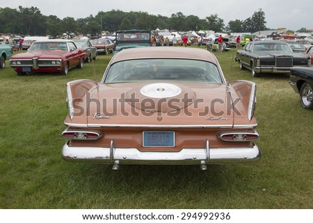 IOLA, WI - JULY 12:  1959 Plymouth Sport Fury Car at Iola 42nd Annual Car Show July 12, 2014 in Iola, Wisconsin. - stock photo