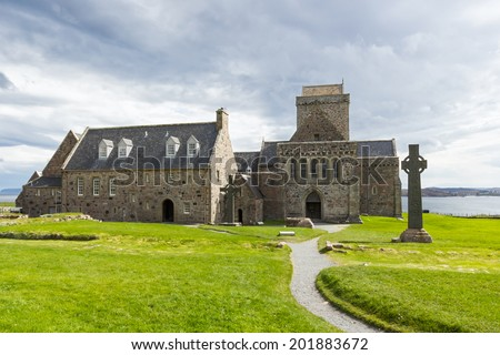 Iona Abbey is located on the Isle of Iona, just off the Isle of Mull on the West Coast of Scotland. It is one of the oldest and most important religious centres in Western Europe. - stock photo