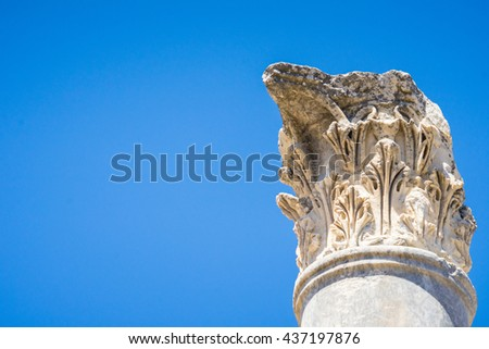 Ionic column capital with scrolling volutes and blue sky.doric column - stock photo