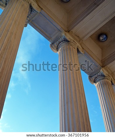Ionic columns against a blue sky