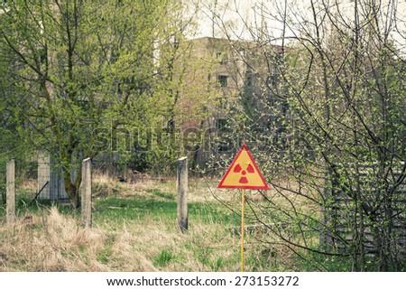 Ionizing Radiation sign near Chernobyl nuclear power plant zone of alienation, Ukraine - stock photo