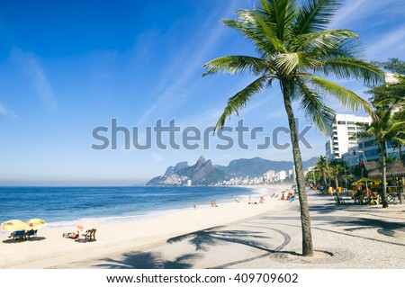 Ipanema Beach, Rio de Janeiro, Brazil scenic view with Two Brothers Mountain with palm tree