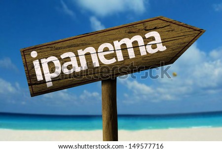 Ipanema, Brazil wooden sign with a beach on background   - stock photo