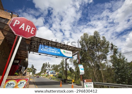 IPIALES, COLOMBIA, MARCH 2: Road border between Ecuador and Colombia with sign road stop. Colombia 2015 - stock photo