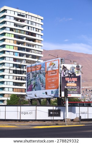 IQUIQUE, CHILE - JANUARY 23, 2015: Sign along Arturo Prat Chacon avenue informing about the construction and sale of new apartments and houses on January 23, 2015 in Iquique, Chile.  - stock photo