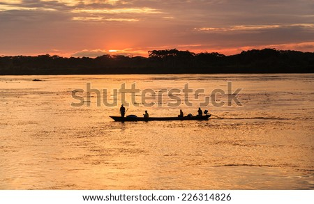 Iquitos, Peru: Sunrise in the Amazon river - stock photo