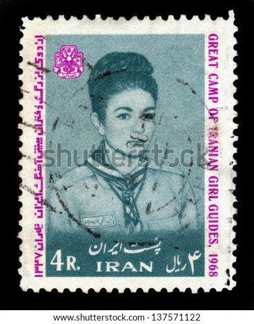 IRAN - CIRCA 1968:A stamp printed in Iran shows girl portrait from girl guides, circa 1968 - stock photo