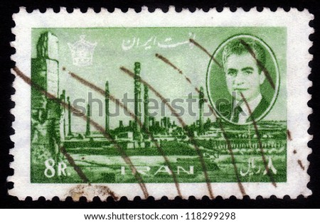 IRAN - CIRCA 1966: A stamp printed in Iran shows Shah Mohammad Reza Pahlavi, on background of ruins of Persepolis, capital of ancient Persia, destroyed armies of Alexander of Macedon, 1966