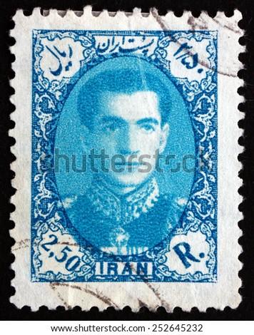 IRAN - CIRCA 1957: a stamp printed in the Iran shows Mohammad Reza Shah Pahlavi, Shah of Persia, circa 1957 - stock photo