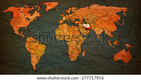 iran flag on old vintage world map with national borders - stock photo