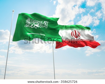 Iran & Saudi Arabia Flags are waving in the spring of the blue sky.
