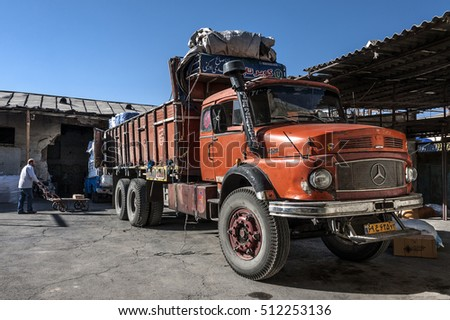 Iran, Shiraz - October 04, 2016: Red old Mercedes truck is about to be loaded with goods.
