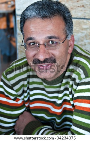 Iranian Arabic man, having a rest at a coffee shop - stock photo