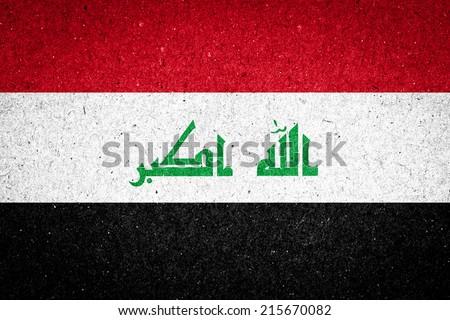 Iraq flag on paper background - stock photo