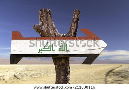 Iraq wooden sign with a desert background - stock photo