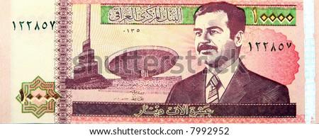 Iraqi 10000 Dinar note - Obverse showing Saddam Hussein - stock photo