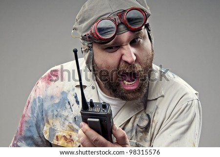 Irate Aviator on his Walkie-talkie - stock photo