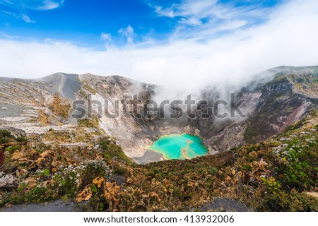 Irazu Volcano to the emerald lake in the crater. Central America. Costa Rica - stock photo