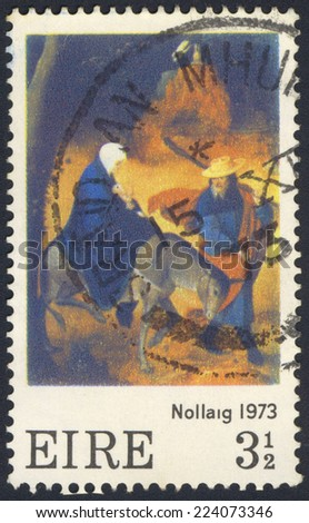 IRELAND - CIRCA 1973: A stamp printed in Ireland shows Christmas Stamp, Nillaig, Flight into Egypt by the 16th century (1500s) painter Jan de Cok, In the National Gallery, Dublin, circa 1973 - stock photo