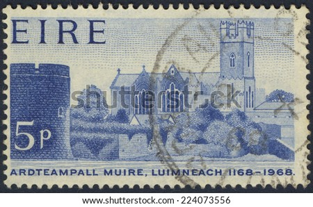 IRELAND - CIRCA 1968: A stamp printed in Ireland shows image of Ardteampall Muirce in Luimneach, circa 1968 - stock photo
