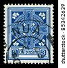 IRELAND-CIRCA 1922:A stamp printed in IRELAND shows image of Celtic cross  is a symbol that combines a cross with a ring surrounding the intersection, circa 1922. - stock photo