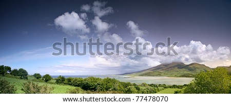 Ireland landscape with clouds mountains sea the ocean and the beach - stock photo